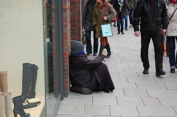 Beggar in one of the most popular shopping streets in Hamburg - February 2014