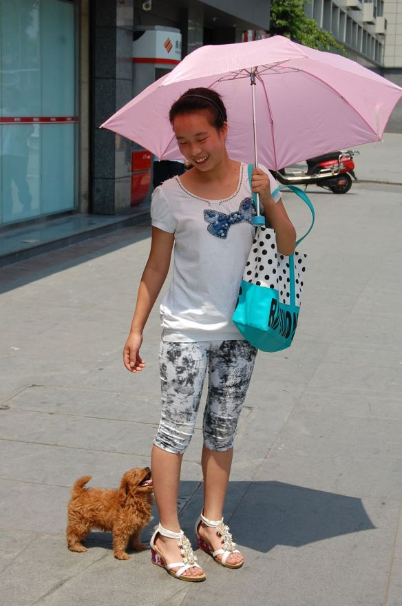 A woman and her loved dog in the summerheat of Chengdu